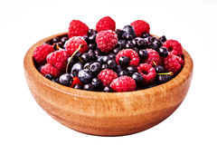 Testy fresh berries. In wooden plate Stock Photo