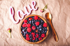 Testy fresh berries. In wooden plate and spoon Royalty Free Stock Image