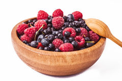 Testy fresh berries. In wooden plate and spoon Royalty Free Stock Photography
