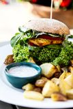 Vegean burger with lettuce, tomato, and potato stock images