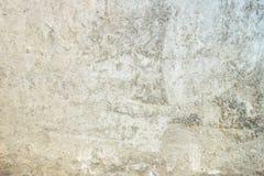 Tesxtured灰泥有困厄的标号的背景墙壁 免版税库存照片