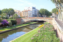 Tet river and a bridge in Perpignan between some buildings Stock Photo