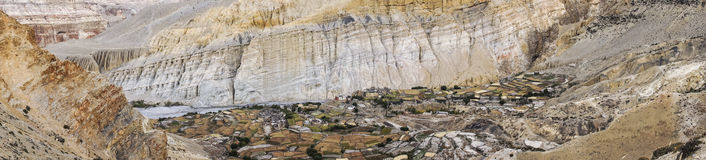 Tetang village at the entrance of Mustang. Panorama of the citadel town of Tetang in Mustang. Culture, monastery in the colors of autumn. Mineral ocher and Stock Image