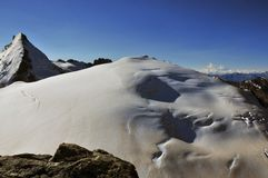 Tete de Valpelline. The glacier covered beautiful summit of the Tete de Valpelline (3802m) on the Italian Swiss border. The north west route can be seen on the Stock Photography