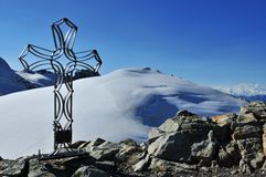 Tete de Valpelline and Iron Cross. The summit of the Tete de Valpelline (3802m) in the Swiss Alps seen from the summit of the Tete Blanche (3724m). The route to Stock Photography