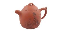 Tetera de cerámica anaranjada con el gráfico tradicional foto de archivo