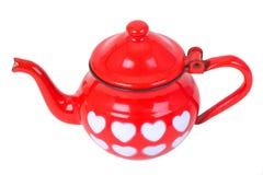 Tetera roja de la vendimia con los corazones pintados Foto de archivo libre de regalías