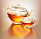 Tetera y taza de cristal con té con amor Fotos de archivo