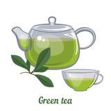 Tetera y taza de cristal con té verde Imagen de archivo libre de regalías