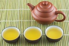 Tetera y taza de té Foto de archivo