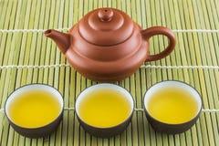 Tetera y taza de té fotografía de archivo