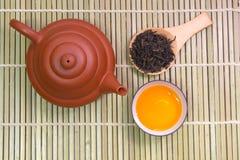 Tetera y taza de té Fotografía de archivo libre de regalías