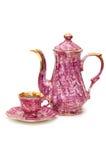 Tetera y taza de té aisladas Imagen de archivo libre de regalías
