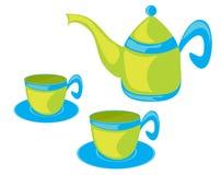 Tetera y tazas. Imagen de archivo
