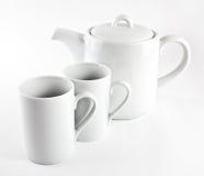 Tetera y tazas Imagen de archivo libre de regalías