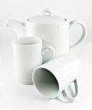 Tetera y tazas Fotografía de archivo libre de regalías