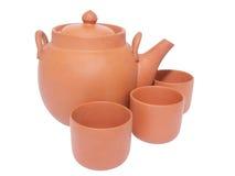 Tetera y tres tazas para el té Imagen de archivo libre de regalías