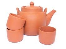 Tetera y tres tazas para el té Fotos de archivo libres de regalías