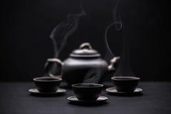 Tetera y tazas de té Fotografía de archivo