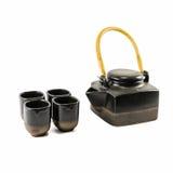 Tetera y tazas de té negras chinas Imagenes de archivo