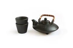 Tetera y tazas orientales negras Foto de archivo libre de regalías