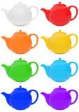 Teteras coloreadas fijadas Imagen de archivo libre de regalías