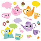 Teteras y tazas de té que hablan Imagen de archivo libre de regalías