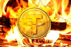 Tether coin or USDT coin buring in Bonfire, Price Value Going down concept. Photo royalty free stock photography