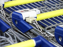Tethred shopping carts. Row of tethred shoppings trollies on the supermarket Royalty Free Stock Image