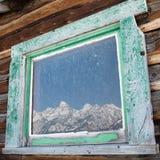 Teton fönsterreflexion Fotografering för Bildbyråer