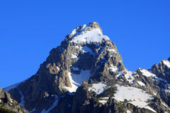 Teton mountain. Closeup of the Grand Teton Mountain peak with snow and blue sky Stock Photo