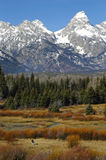 Teton Mountain with man hiking. Teton mountain range with man hiking near river Stock Photography