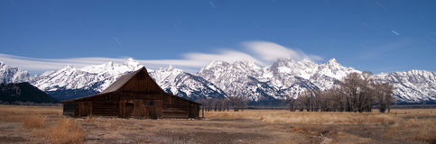 Teton mountain range midnight star shower Stock Photography