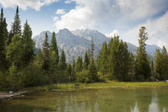 Teton mountain range over Jenny Lake, Jackson Hole, Wyoming. Royalty Free Stock Photo