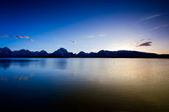 The Teton Mountain Range Reflected in a Lake Stock Photos
