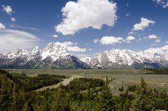 Teton Mountain Range from the Snake River. Crossing Stock Photography