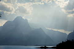 Teton Mountains, curtain of sun rays, Jackson Hole, Wyoming. Royalty Free Stock Image
