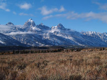 Teton Mountains in Wyoming. With snow and low clouds behind a homestead farm in Grand Teton National Park Stock Photo