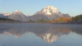 Tetons Fall Reflection Zoom Out stock video footage