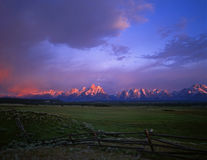 Tetons & Fence. A buck and rail fence with the Grand Teton Mountain Range, in the background, photographed at sunrise.  Location, Grand Teton National Park Royalty Free Stock Photos