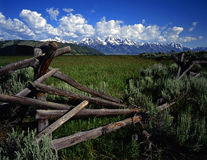 Tetons&Fence#3. A buck and rail fence and the Teton Mountain Range in Grand Teton National Park, Wyoming Stock Image