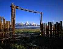 Tetons&Gate#1. A fence, gate and the Teton Mountain Range, in Grand Teton National Park, Wyoming Royalty Free Stock Photo