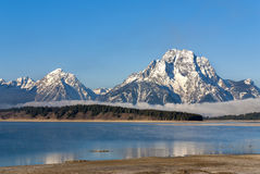 Tetons at Jackson Lake with snow Royalty Free Stock Image