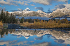Tetons Reflected in Fall at Sunrise Stock Photo