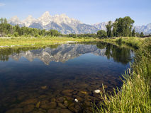 Tetons reflected in Snake River Stock Images