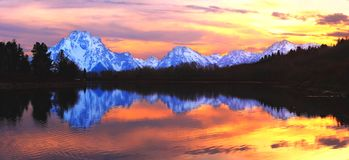 Tetons and Snake River Panroama. The Grand Tetons at sunset reflecting in the Snake River, from Oxbow Bend - Grand Teton National Park, Wyoming Stock Photo