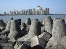 Tetra-pods at Mumbai shoreline. Array of break wave tetra pods to protect city wall Stock Photos