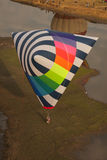 Tetrahedron shaped hot air balloon. On a mud flat Royalty Free Stock Photo