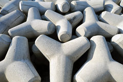 Tetrapods. Breakwater with concrete blocks , tetra pods Royalty Free Stock Photography