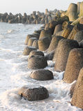 Tetrapods made of concrete protect the coast of Sylt. The coastline of the Island of Sylt is perpetually changed by erosion. Barriers from tetrapods made of Royalty Free Stock Photos